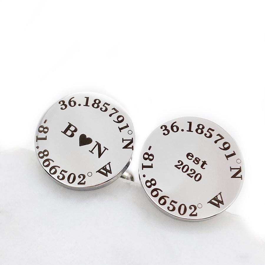 "5/8 inch silver stainless steel round cufflinks. location coordinates engraved along round edge. Engraved ""B"", solid heart ""N"" in the center of one lcoation cufflink. The second cufflink is engraved with ""est 2020""."