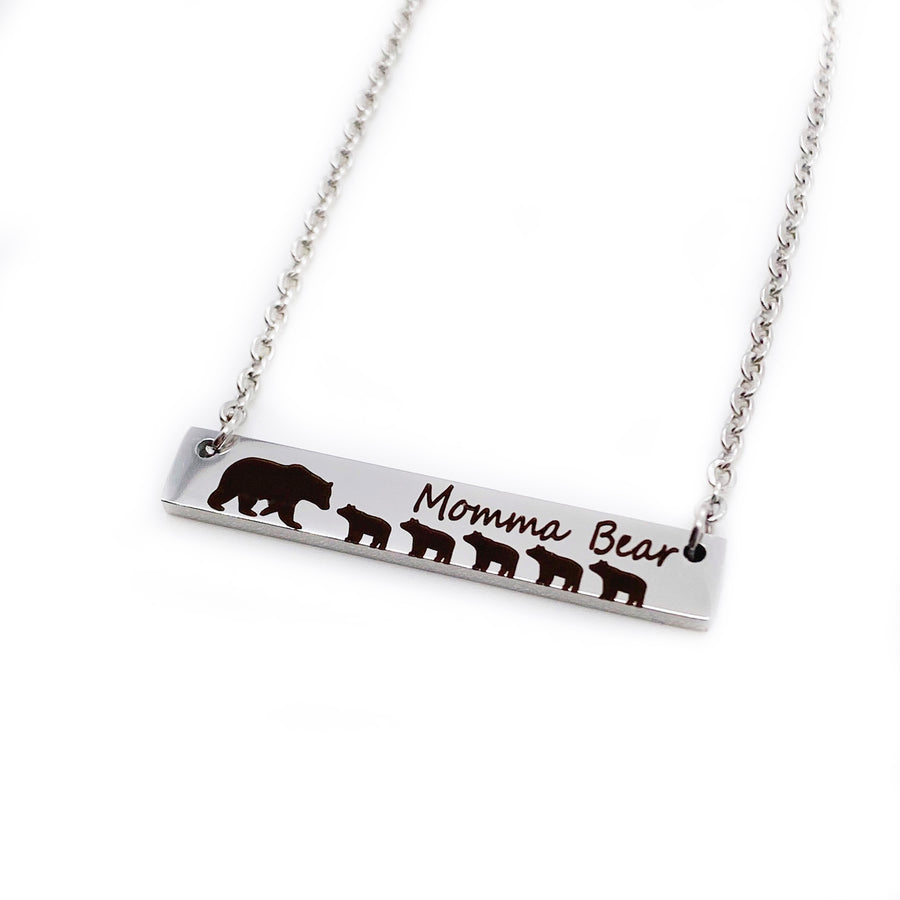 "silver engraved bar necklace with 5 bear cubs and a mom bear. engraved with ""momma Bear"" and attached to a silver stainless steel cable chain"
