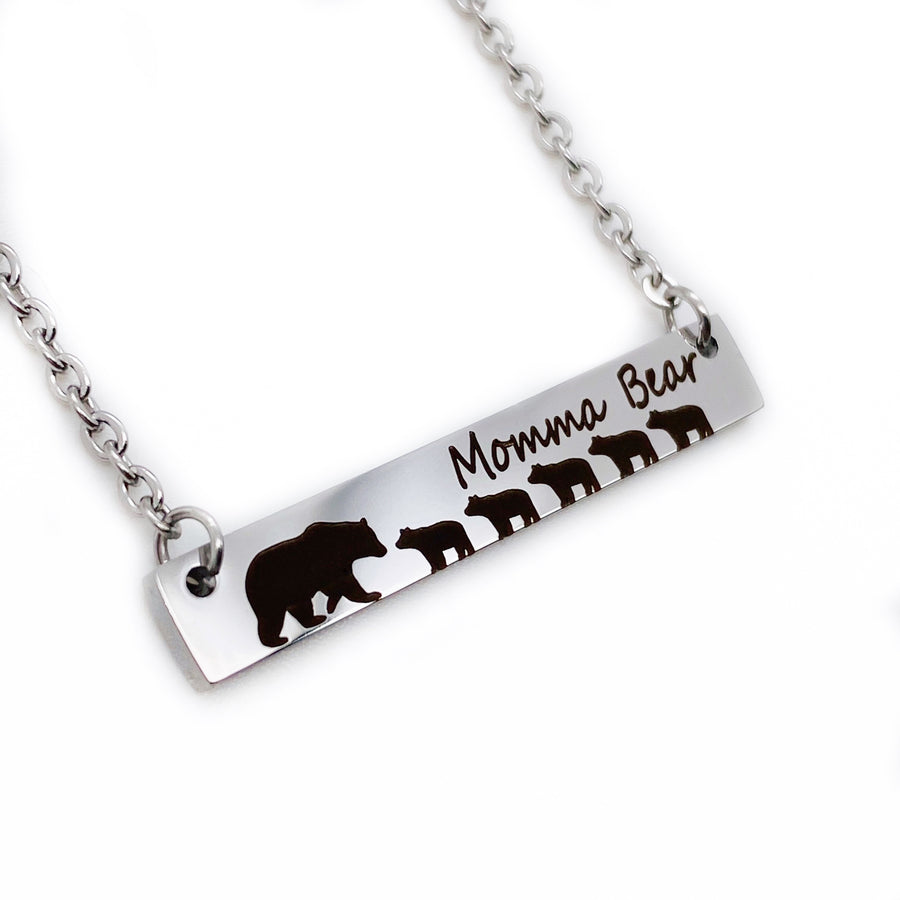 "silver engraved bar necklace with 5 bear cubs and a mom bear. engraved with ""momma Bear"" and attached to a silver stainless steel cable chain left side view"
