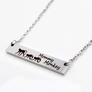 silver mommy monkey horizontial bar necklace with baby monkies
