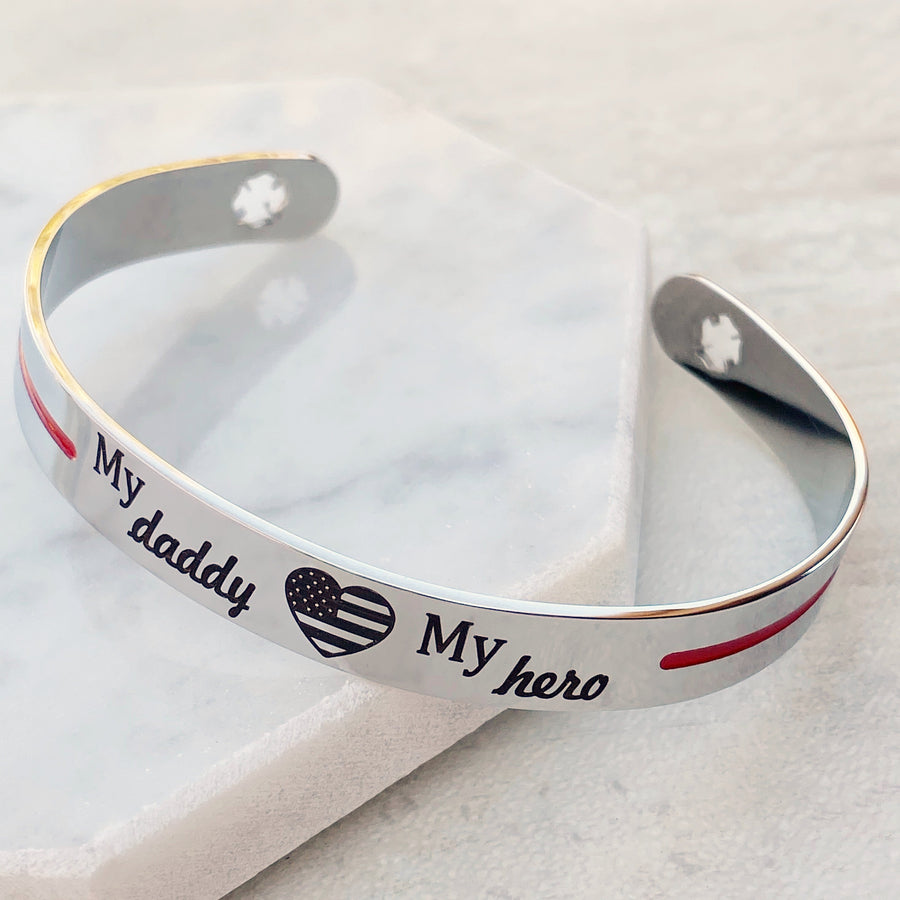 Silver stainless steel cuff bracelet thin red line with the engraving my daddy my hero with an american flag heart and maltese fireman cross cutout
