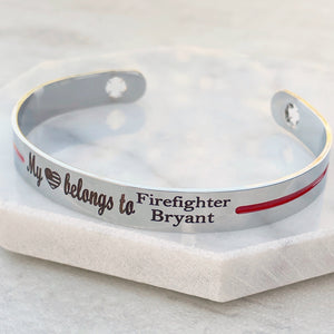 Silver stainless steel cuff bracelet with maltese cross fireman cutout symbol with engraved my american flag heart shape belongs to firefighter bryant