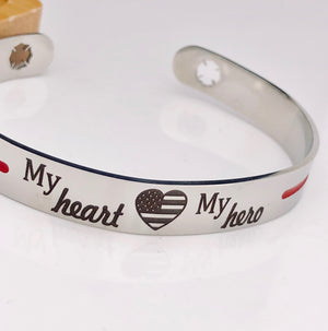 Silver stainless steel cuff bracelet thin red line with the engraving my heart my hero with an american flag heart and maltese fireman cross cutout