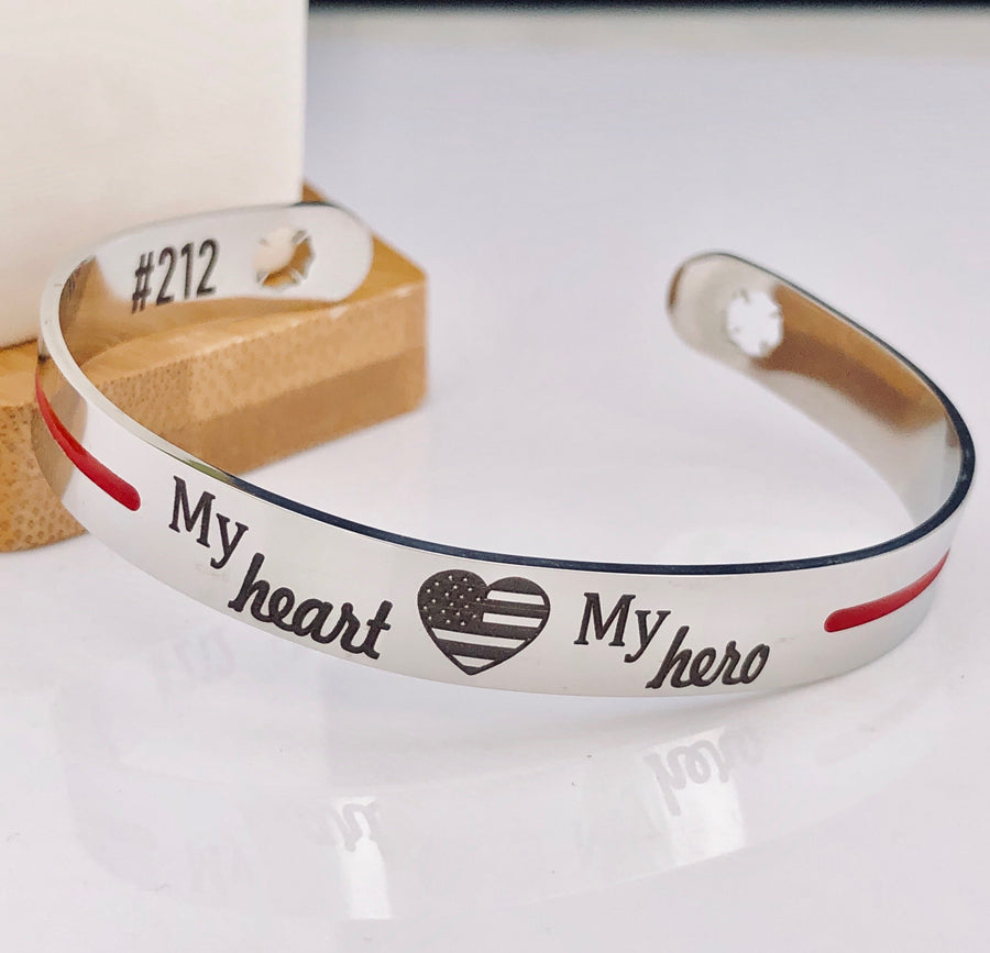 Silver stainless steel cuff bracelet thin red line with the engraving my heart my hero with an american flag heart and maltese fireman cross cutout with house number