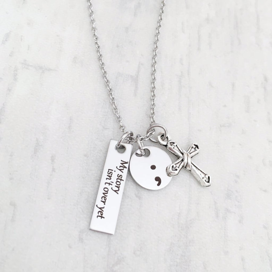 my story isn't over yet semicolon awreness necklace cross