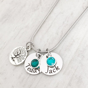 mother's tree of life necklace with children's names on disc