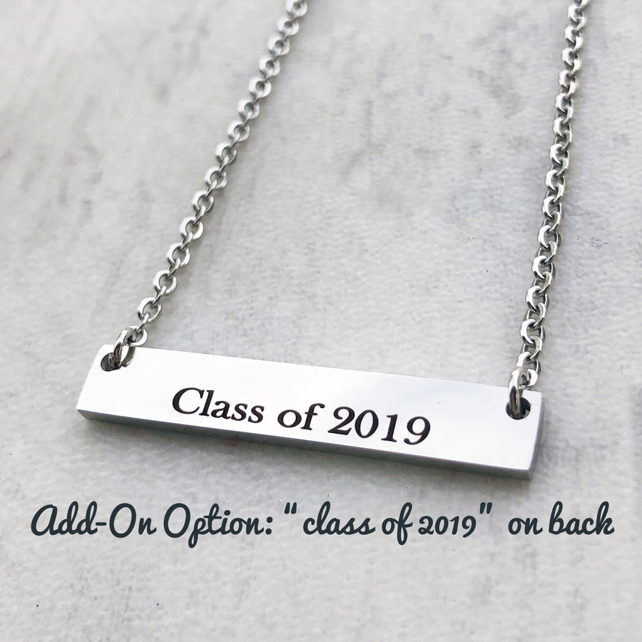 class of 2019 on a silver bar back of the bar