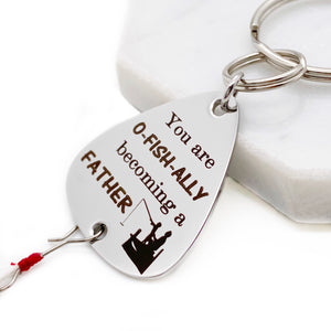 fishing lure engraved with You are o-FISH-ALLY becoming a FATHER with an image of a dad and son fishing off a dock