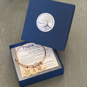 bracelet in blue jewelry gift box with thank you card