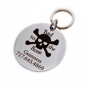 "Silver stainless steel dog collar id tag with black engraving ""Bad to the Bone"" with a picture of cross bones, pets name and telephone number"