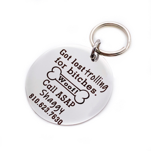 "Silver stainless steel dog collar id tag with black engraving ""Got lost trolling for bitches. Call ASAP"" with a picture of a dog bone, pets name and telephone number"