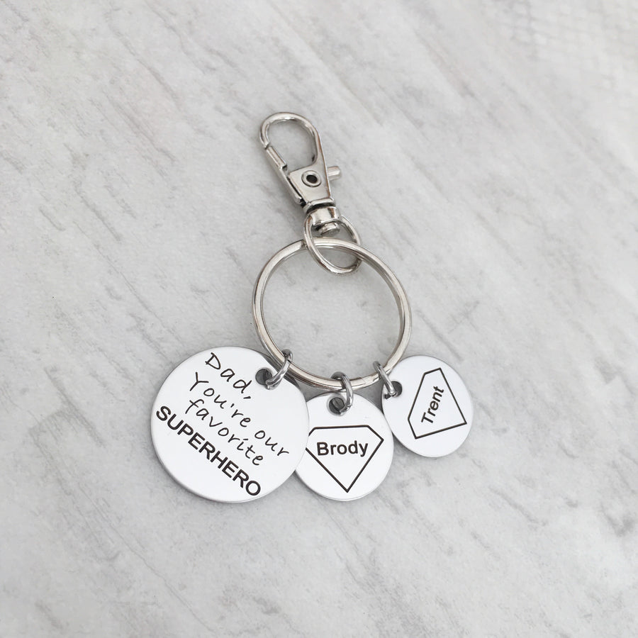 "Keychain engraved with Superman symbol, children's names and ""Dad, you're our favorite superhero"""