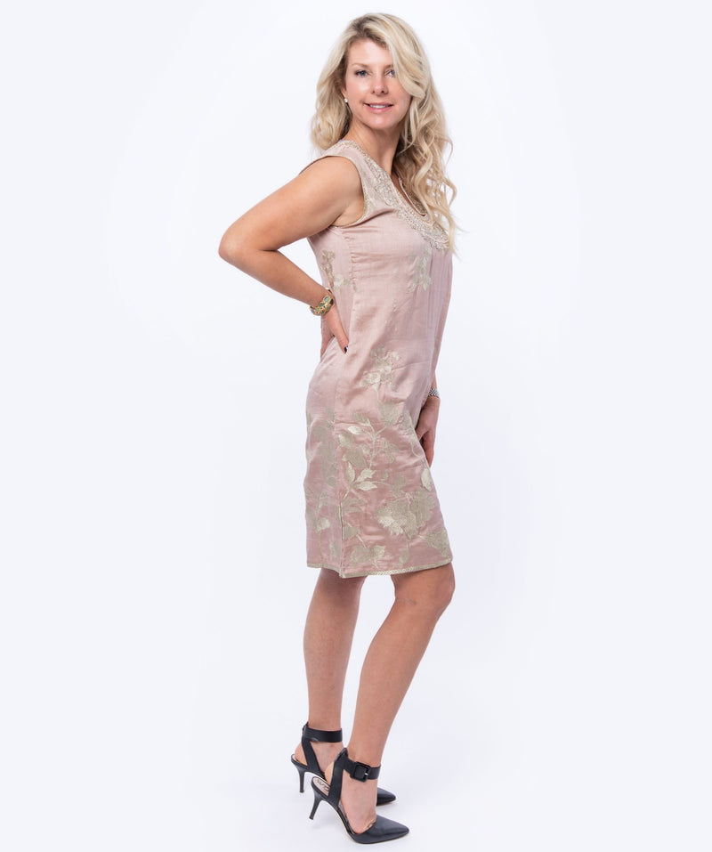 Sleeveless dress in pink silk brocade with embroidery detail around neckline and the back of the dress.