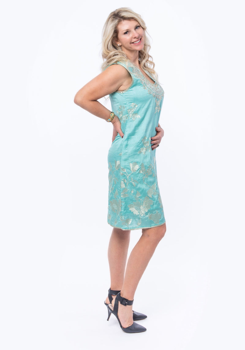 Sleeveless dress in turquoise silk brocade with embroidery detail around neckline and the back of the dress.
