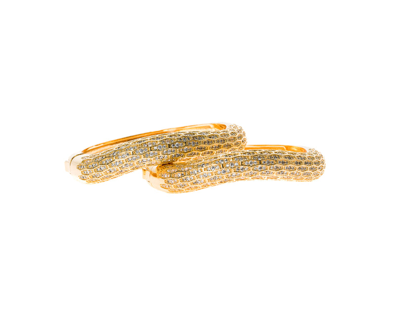 Simple, classic, and beautiful in a stack or alone, the Chloe Cuff is the sparkle accent that complements any outfit. This elegant 18k gold electroplated cuff laden with Swarovski crystals features a hinge in the middle. The hinge mechanism makes it easy to get on and off, and comfortable to wear. This handmade cuff goes well with casual, professional, and formal wear; its classic simplicity lends it to any occasion!
