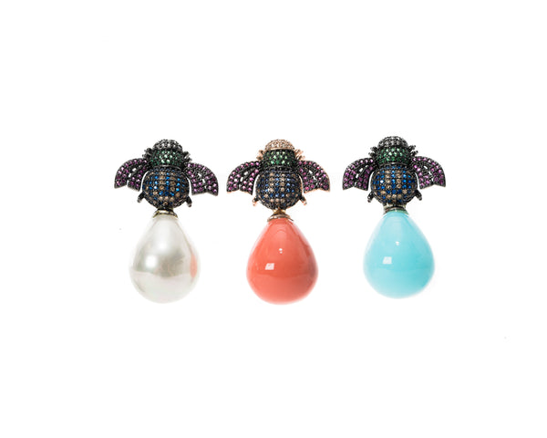 18K gold plated earrings with a bee atop a white pearl or hand enameled drop in either coral or turquoise.