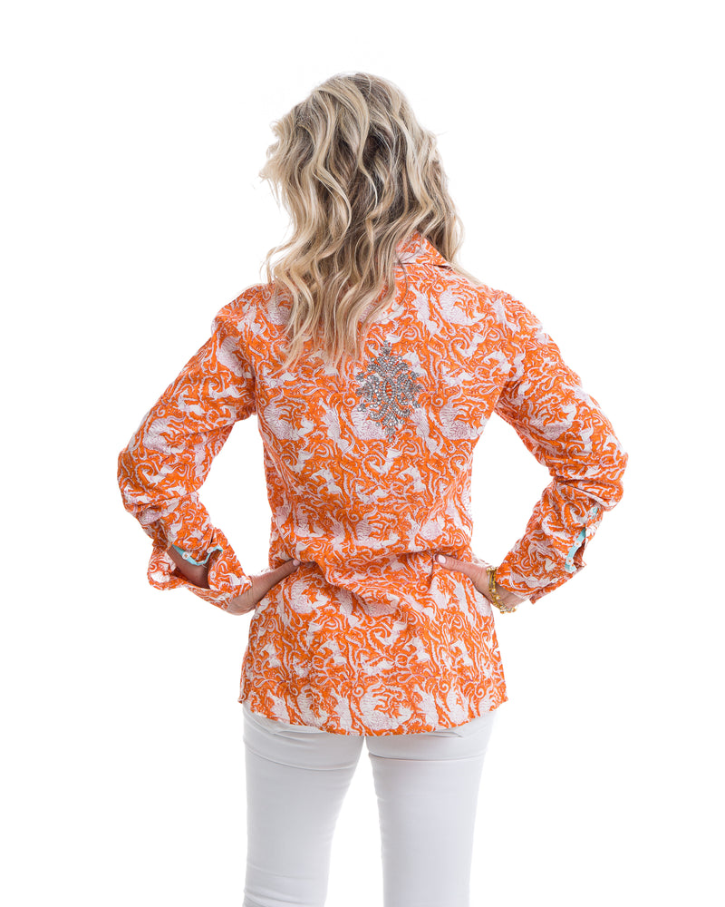Hand block printed cotton shirt in orange with turquoise trim. Embroidery detail in the back of the shirt.