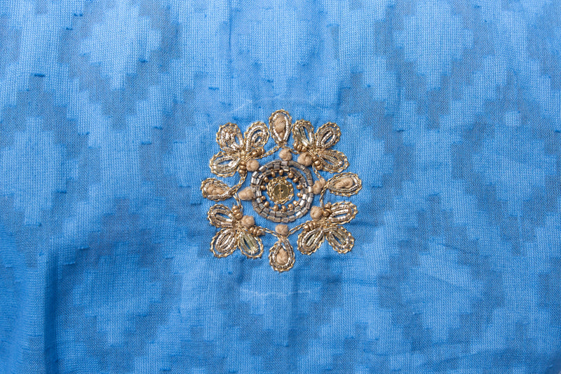 Hand woven blue cotton tunic with intricate gold embroidery detail on sleeves, around the neck and on the back of the tunic.