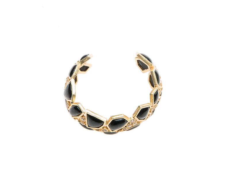 Asymmetrical natural black agate stone is set in gold plated metal around Swarovski crystal to create this cuff that is easy to wear and fits most wrists.