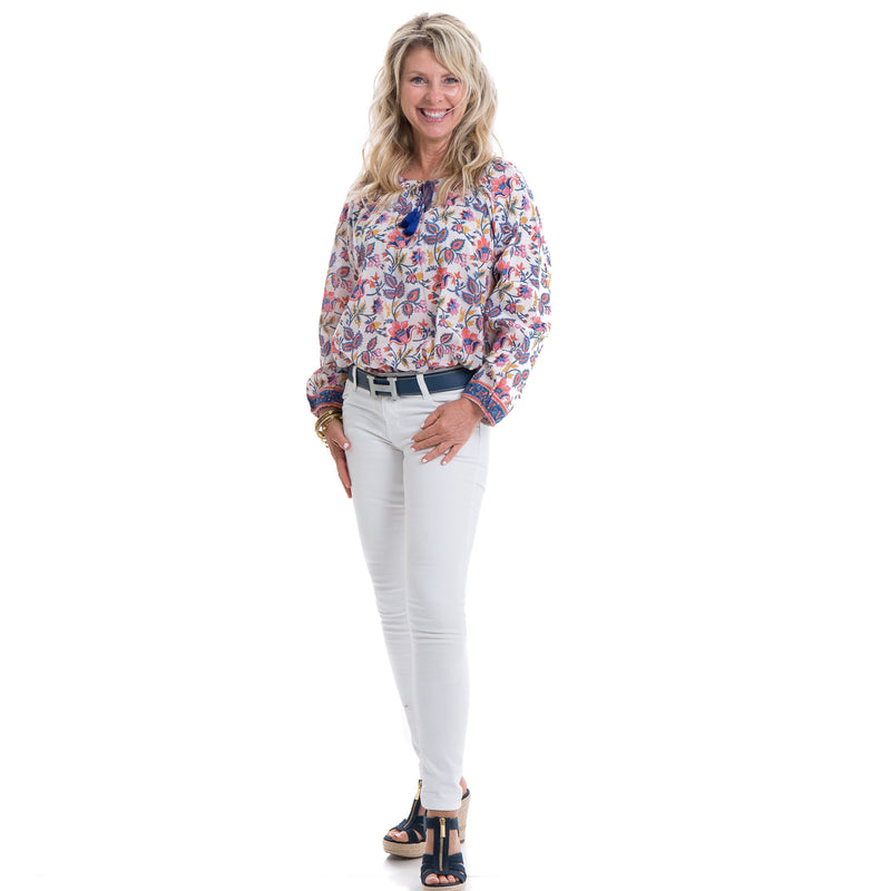 Floral block printed soft cotton full sleeve top with a navy tassel detail .