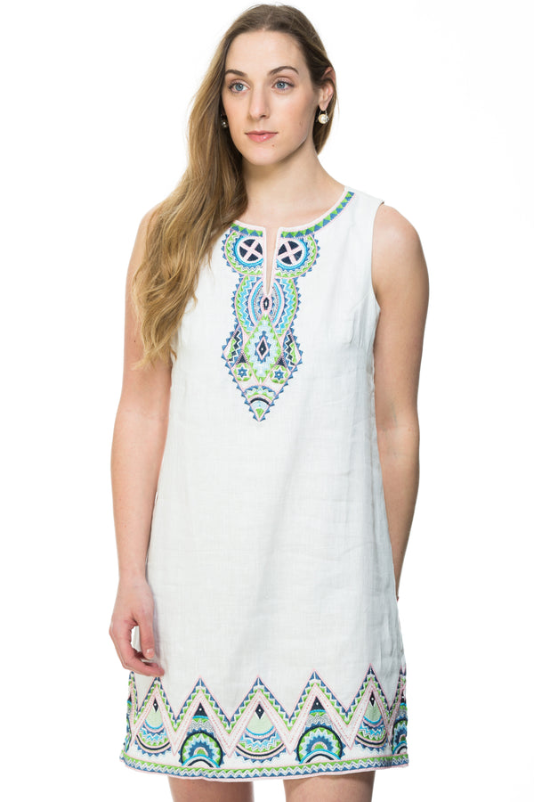 Sleeveless white or blue linen dress with multi colored embroidery along the neck and bottom of the dress.