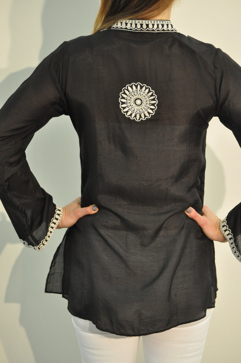 Black cotton silk tunic with extensive white beading and embroidery around the neck, sleeves and back of the tunic.