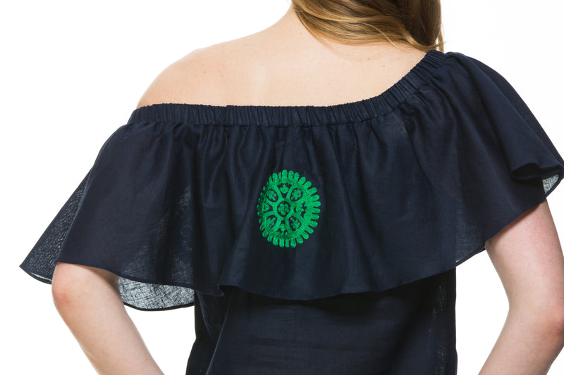 Navy Linen top with green embroidery detail. This top can be worn of the shoulders or as a scoop neck. It has a frill detail around the neckline.