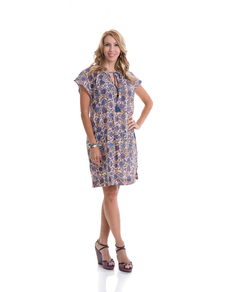 This is the Yatra, Hillsboro dress. 100% cotton dress with a pink and blue, block printed pattern and tassels the the neckline. The dress has cap sleeves and in knee length.