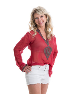 The Ibiza tunic is a sheer chiffon tunic with grey beading and embroidery around the neck and edge of the sleeves. This top is offered in red and black.