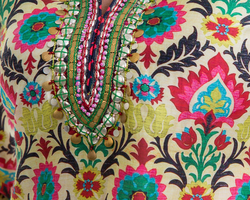 A printed cotton silk tunic with extensive gold embroidery around the neck and back make this a special piece. The print is vibrant and this tunic can be worn all year round.