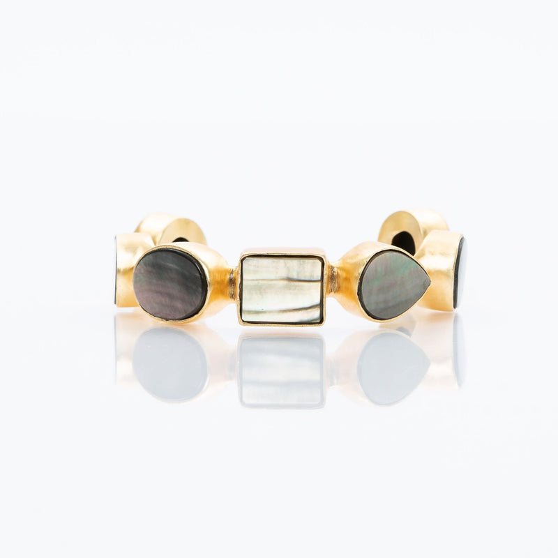 Natural slate mother-of-pearl stones set in brass and 18k electro-gold plated. Adjusts to fit most wrists.