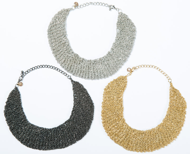 The Ella mesh necklace is hand crocheted and can be worn as a choler. It comes in 3 finishes, gold, white gold and black.