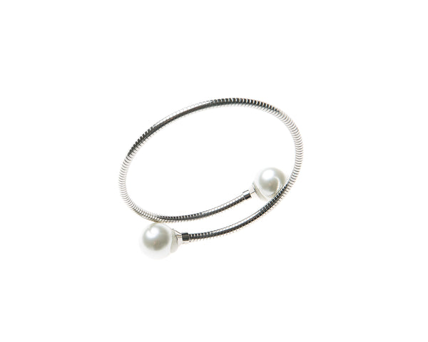Delicate cuff bangle  adorned with pearl on either end. This cuff is easy to wear and fits most wrists. Can be worn alone or staked with other pieces.