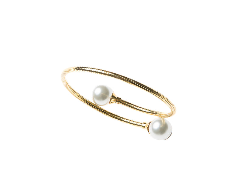 Delicate gold plated cuff bangle  adorned with pearl on either end. This cuff is easy to wear and fits most wrists. Can be worn alone or staked with other pieces.