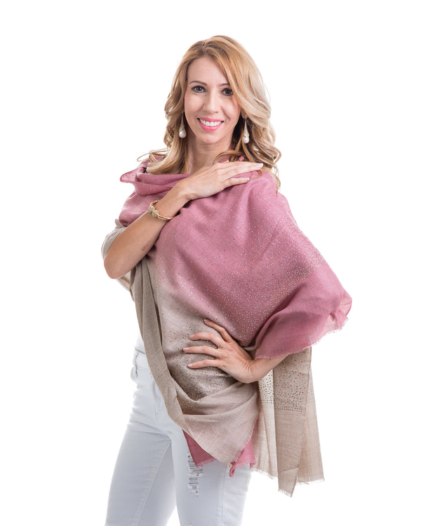 "This image showcases our Felicity shawl. This is a cashmere shawl with an ombre effect ranging from pink to wheat. The shawl is decorated with gold and silver swarovski crystals on the entire shawl. The shawl is 81"" X 29""."