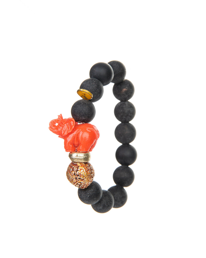 The JOY Bracelets are a must have for all Elephant enthusiasts. Its organic silhouette is crafted by hand. It is hand-strung lava stone bead after bead with flowing fluidity as an easy to wear stretch bracelet to create a sinuous, harmonious whole.  It is the ideal accessory and thanks to its stretchy nature the bracelet is easy to put on and take off. It's all round stones with the organic natural stone ridges connect you to the earth.