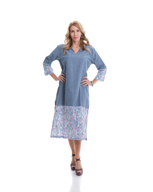 The image shows the Yatra Hope Kaftan Dress. The material is 100% chambray cotton with floral block printed detail at the sleeves and the boson half of the kaftan.
