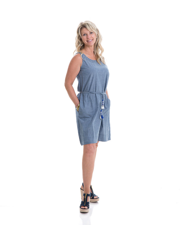 The Isabel dress in chambray is a comfortable everyday sleeveless dress with a tassel belt that helps define the waist.