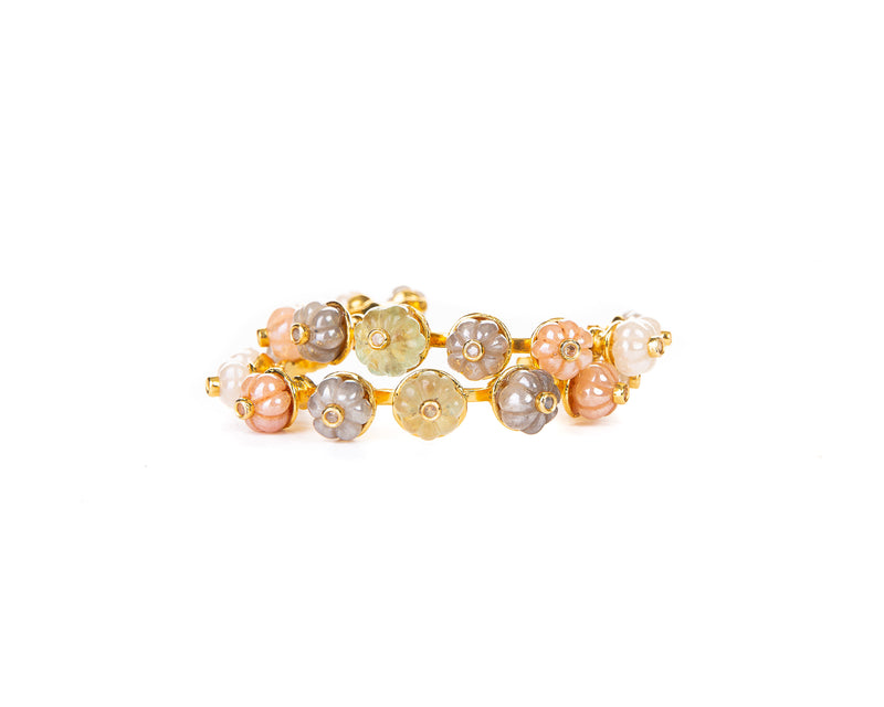 This cuff with 18K gold plating finish is the ideal accessory to a daytime outfit, thanks to its side opening it is easy to put on and take off. Its all-around stones features stones in a traditional watermelon cut and a vivid splash of rainbow colors which will compliment any outfit.  Foundational for any stack and eminently wearable, this is a staple that will accompany you for the rest of your life.