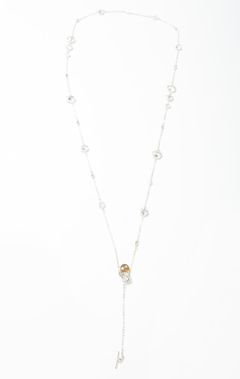 "Delicate necklace with varied sizes of Swarovski crystals. Length of necklace is 40"". This necklace can be worn long or doubled. The toggle clasp makes it easier to wear and take off."