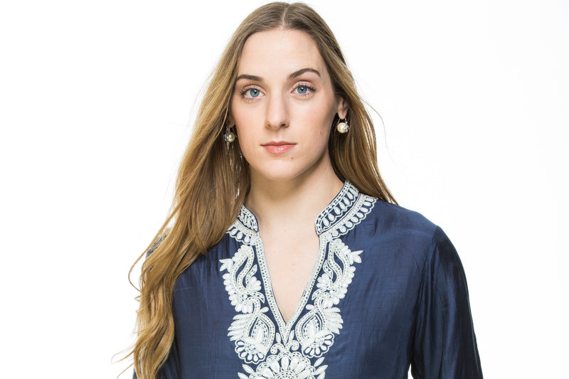 Navy blue cotton silk tunic with extensive white beading and embroidery around the neck, sleeves and back of the tunic.