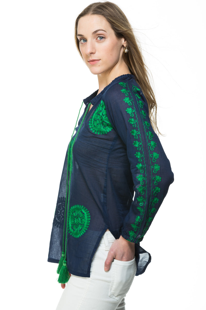 Light weight cotton tunic with extensive embroidery along the length of sleeve, front and back of the tunic. The tunic has a tassel detail that can be tied or left open. Offered in various colors.