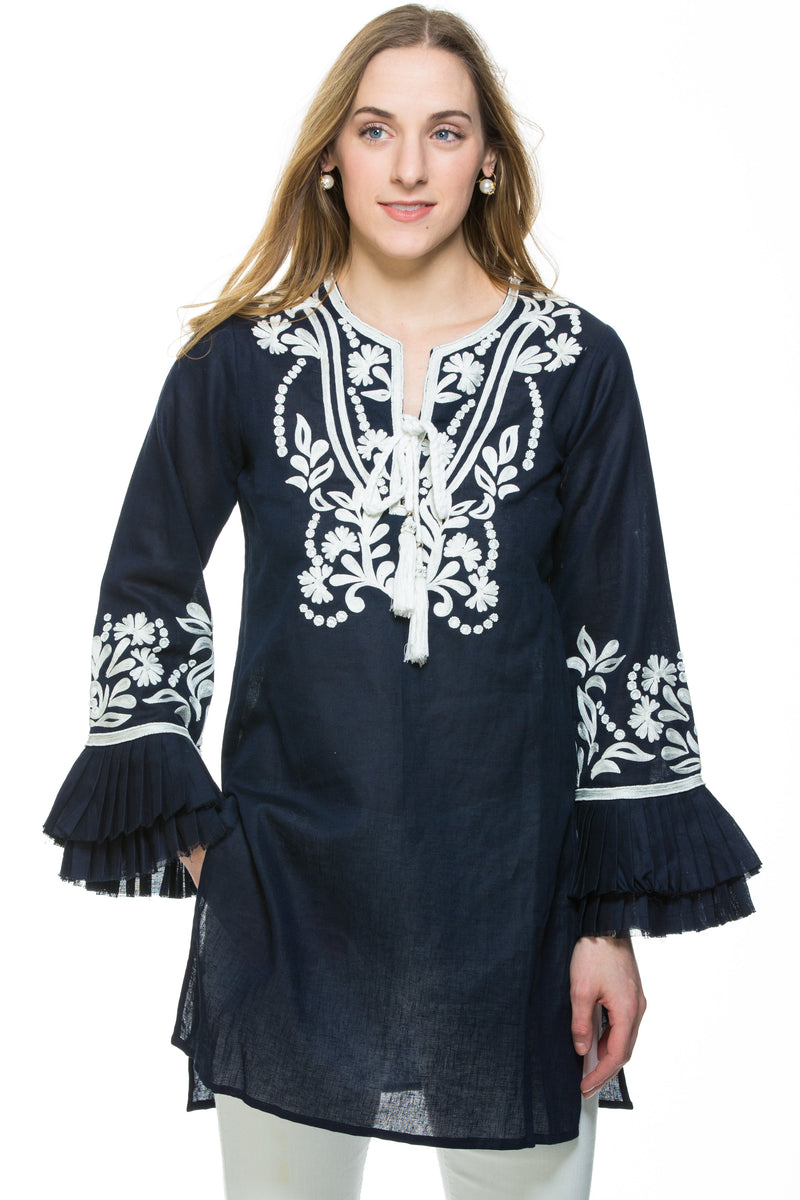 Dressy linen tunic with substantial embroidery detail. The tunic has unique pleated, layered sleeves that are a work of art. Tunic is available in 3 different colors. All tunics have white embroidery details.