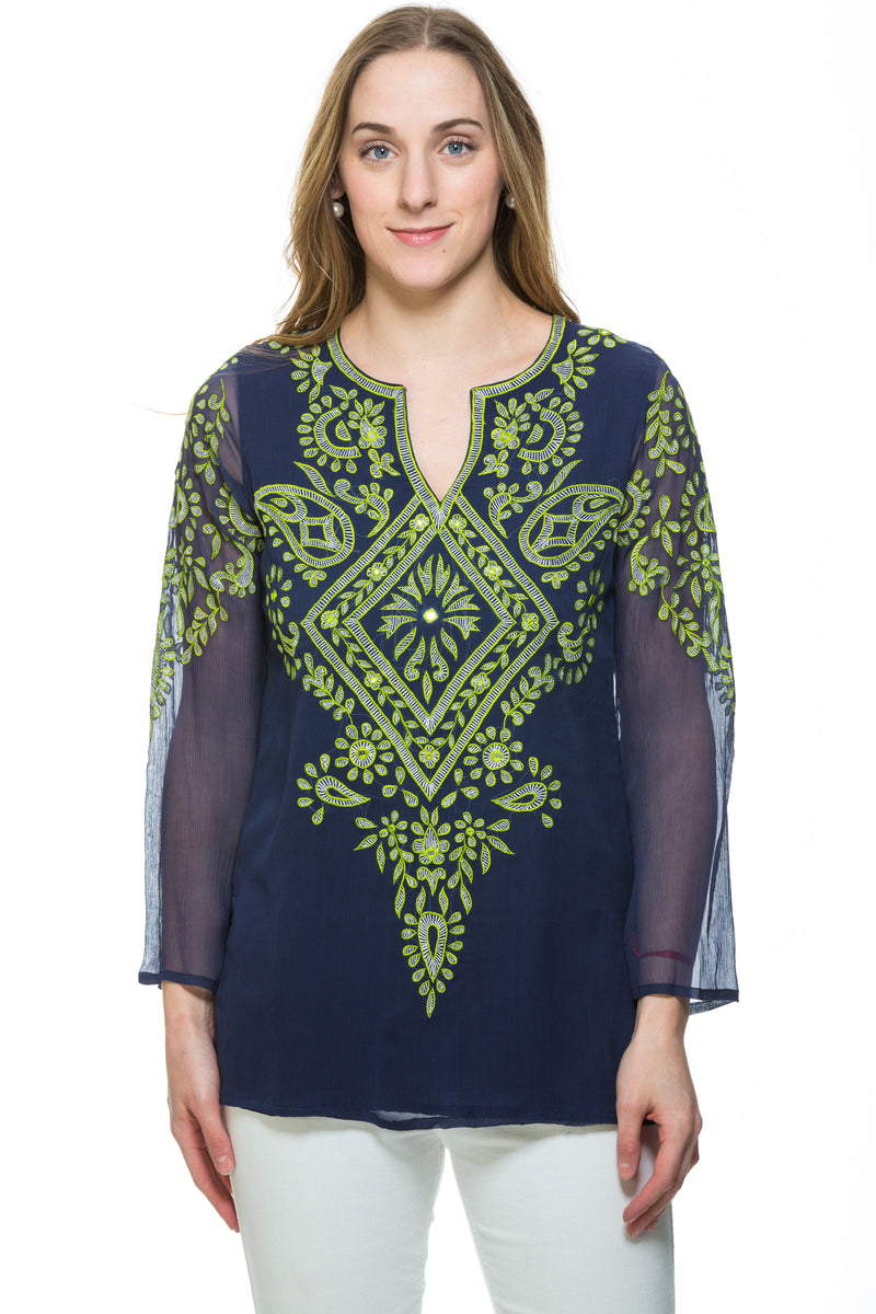 This silk chiffon navy tunic has extensive green embroidery along the front and sleeves of the garment. There is a motif at the back of the tunic as well. The sleeves of the tunic are sheer but the rest of the tunic is lined.