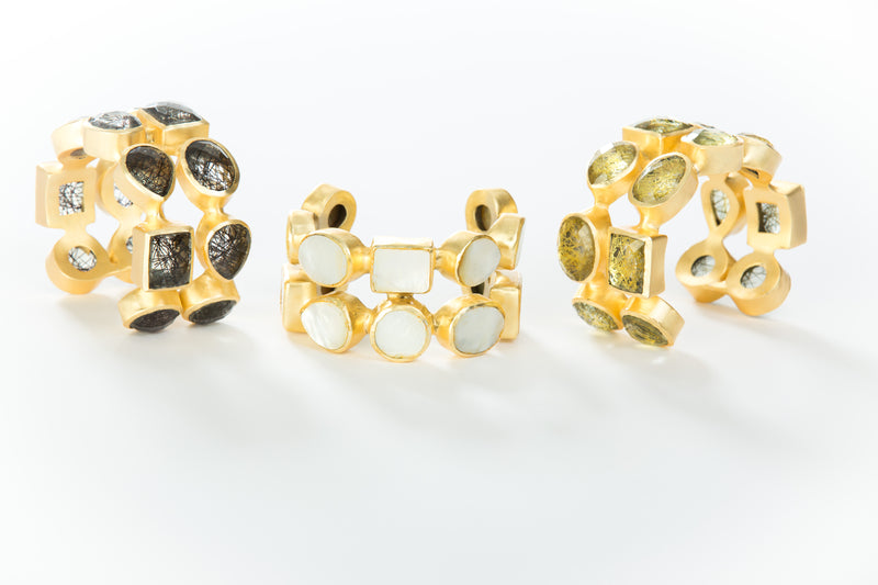 Two rows of natural gold rutilated quartz set in brass and 18k electro-gold plated. Adjusts to fit most wrists.
