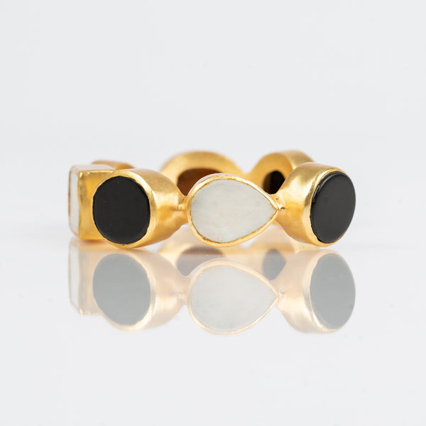 Natural black onyx and mother-of-pearl stones set in brass and 18k electro-gold plated. Adjusts to fit most wrists.