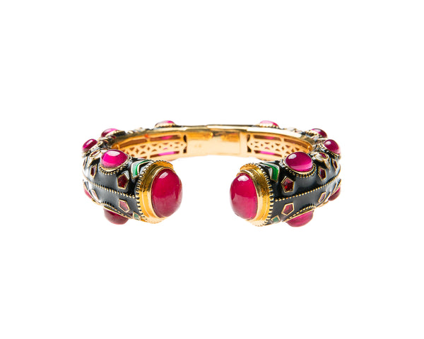 This is a special occasion cuff embellished with semi precious stones and enamel work. The enamel work is an ancient Indian art form.
