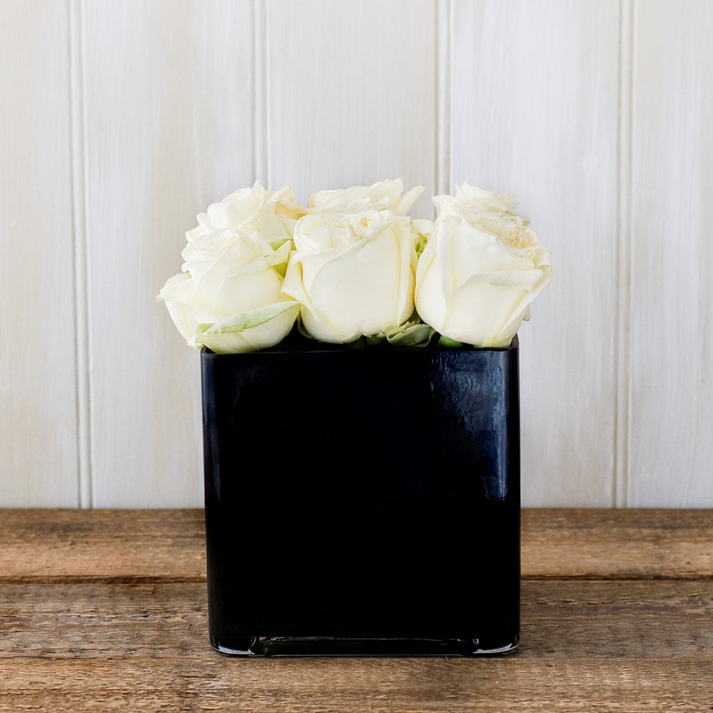Black cube vase with white Avalanche roses