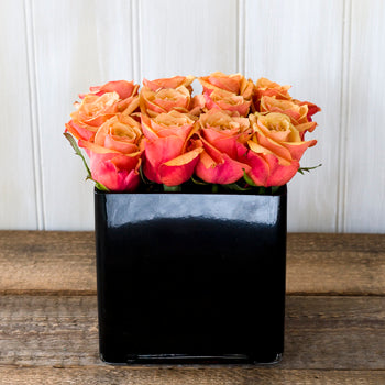 Cherry brandy orange roses in a black cube