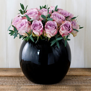 Image of Memory Lane roses and foliage in a black goldfish bowl vase